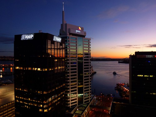 """auckland newzealand city sunrise morning view netartii """"exoticimage pwpartlycloudy colour dark harbour ferry water light sign logo building glass windows reflection early dawn downtown blue calm peaceful lines boat"""