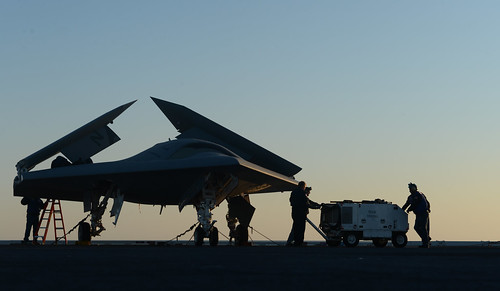 <p>Northrop Grumman personnel conduct preoperational tests on a U.S. Navy X-47B Unmanned Combat Air System demonstrator aircraft on the flight deck of the aircraft carrier USS George H.W. Bush (CVN 77) May 14, 2013, in the Atlantic Ocean. The George H.W. Bush was the first aircraft carrier to successfully catapult-launch an unmanned aircraft from its flight deck. (DoD photo by Mass Communication Specialist 2nd Class Timothy Walter, U.S. Navy/Released)</p>