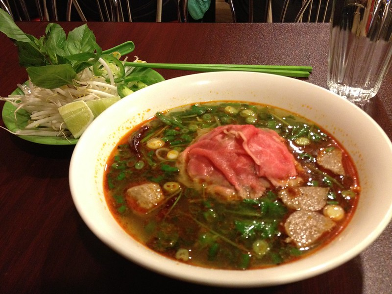 Bowl of spicey lemongrass Pho with thin sliced rib eye steeak and meatballs