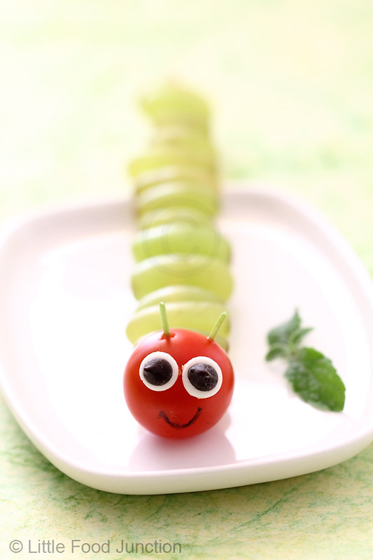 Just thread some grapes and a cherry tomato on a wooden skewer