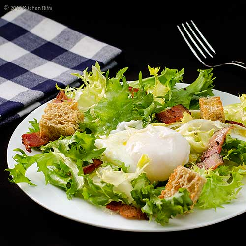 Salade Frisée aux Lardons on Plate with Poached Egg