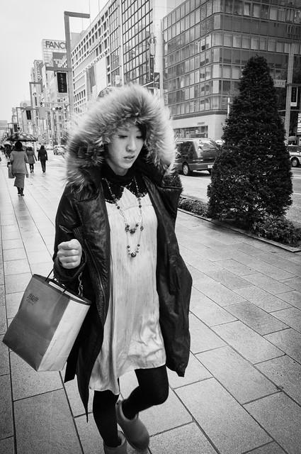 Woman walking down Ginza, Tokyo.