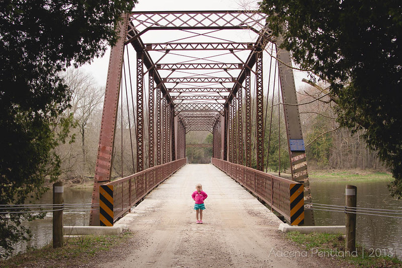 Small girl, Big bridge, Less snow.