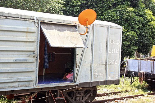 this man lives in a box car. complete with satellite tv.