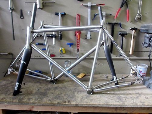 A pair of steel cross bikes ready for paint