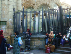 Women gather outside the Sayeda Zeinab mosque in Cairo, revered by Shia and Sunni alike. Credit: Cam McGrath/IPS.