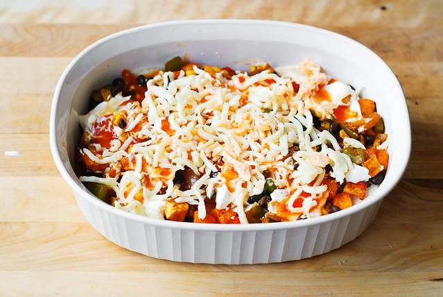 Sprinkle mozzarella cheese over the sour cream and enchilada sauce