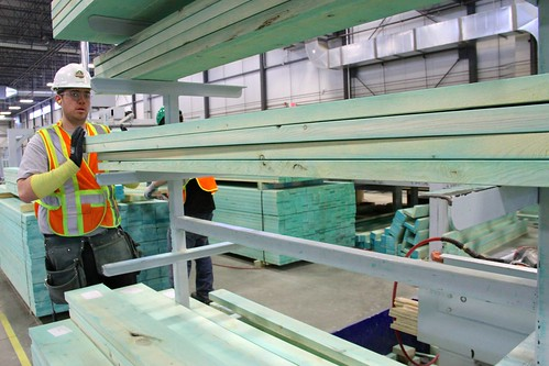 A worker in the Landmark Homes manufacturing plant in Edmonton Alberta