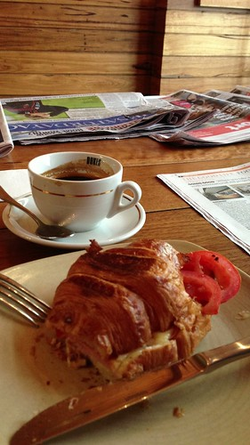 Coffee with a ham, cheese and tomato croissant at Speakeasy Kitchen in South Yarra