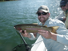 TomSteele, Northern California fly fishing guide poses a hefty spring Rainbow