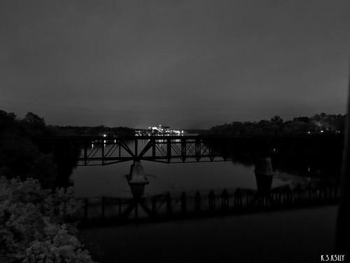 silhouette railroadbridge nightimereflections facingsouth facingdowntown