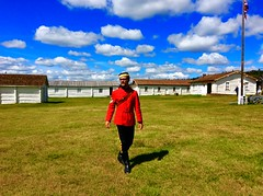 A Fort Walsh tour guide, dressed in his red serge jacket, played his role as a Sergeant in the North-West Mounted Police to a tee (a series)