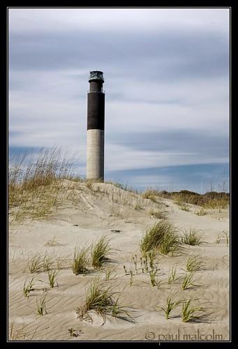 sky usa lighthouse beach clouds nc sand seascapes dunes northcarolina oakisland canon50mmf14 oakislandlighthouse coastalscenes paulmalcolm