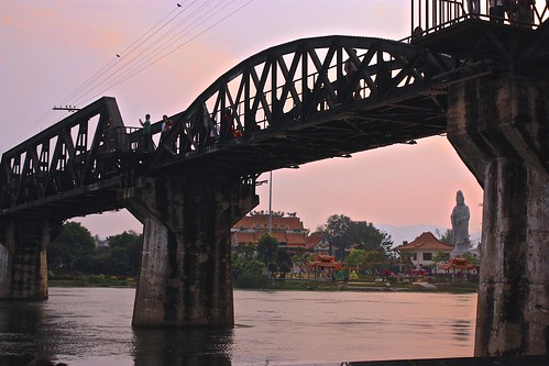 undershot of the bridge over River Kwai, monastery in the background