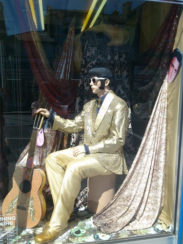 22 - Golden Elvis in the window of A-One Fabrics