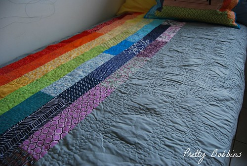 rainbow i spy quilt back on bed