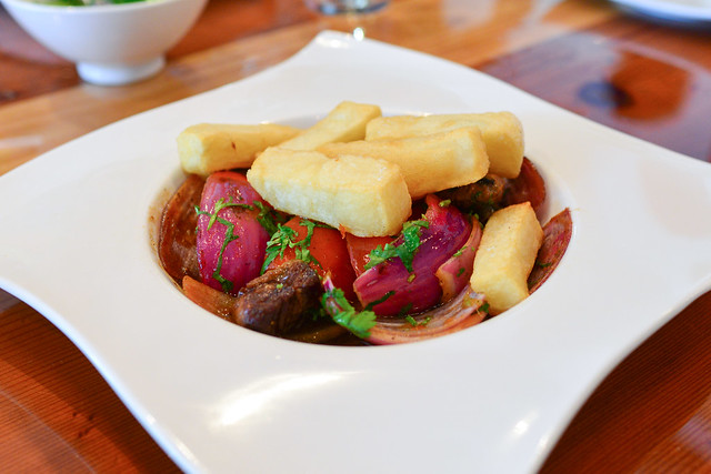 LOMO SALTADO  Sautéed beef filet, roma tomatoes, red onions, ginger, garlic, soy sauce, banyuls vinegar, Kennebec fries