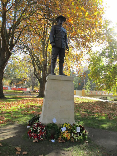 Wreaths by the statue of Sergeant Henry Nicholas