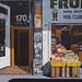 fruit shop on Cuba Street by Lester Ralph Blair