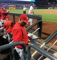Phillies hitting coach Steve Henderson uses an iPad in the dugout.