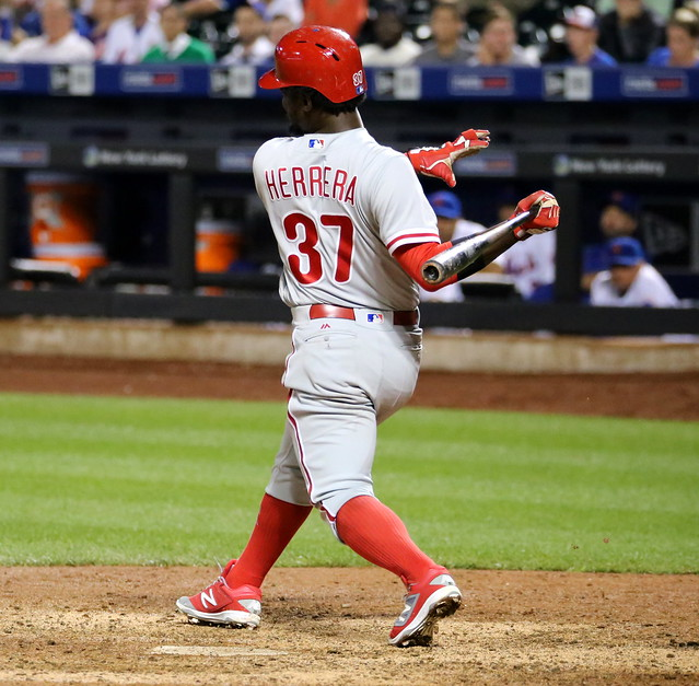 The Phillies' Odubel Herrera swings at a pitch in the 11th inning.