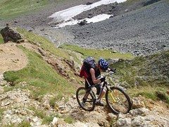 More Pushing and Carrying the bikes over the rocky ground of the Col du Bonhomme 2329m Image