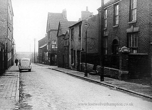 Montrose Street with  Meynell Valves on the left alongside the car in the 1960's.