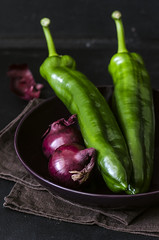 Vegetables: violet onion and green pepper