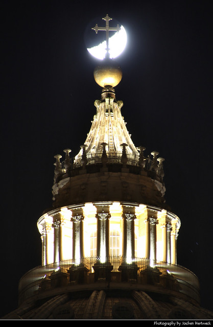 Moon behind the spire of Basilica di San Pietro, Vatican City