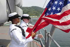 Sailors hoist the national ensign as USS Boxer (LHD 4) docks in Kota Kinabalu, Aug. 9.  (U.S. Navy/MCSN Eric Burgett)