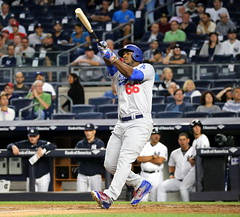 The Dodgers' Yasiel Puig swings at a pitch in the first inning.
