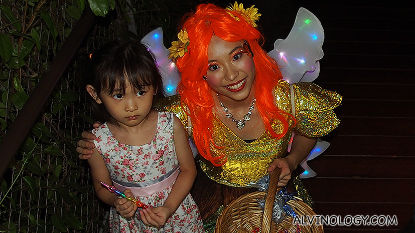 A fairy giving out free candies to kids at the event