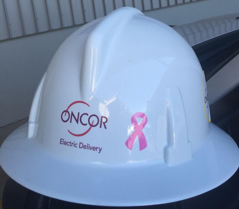 Pink ribbon on hard hat