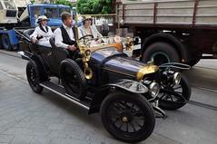 ford(0.0), hot rod(0.0), automobile(1.0), wheel(1.0), vehicle(1.0), touring car(1.0), antique car(1.0), vintage car(1.0), land vehicle(1.0), luxury vehicle(1.0), motor vehicle(1.0),
