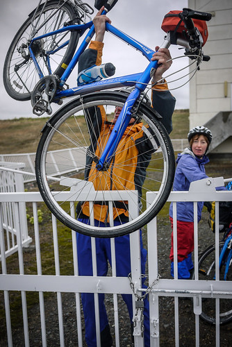 Hauling a bike over a gate (near Shinshinotsu Town, Japan)