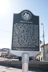 Photo of Mills Wharf black plaque