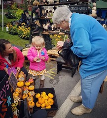 I went to the Remsen Barn Festival this weekend with my mom and grandma (as a shopper, not a vendor). This adorable 3 year old daughter of one of the craft vendors was selling pumpkins that she had painted herself. They were $1, so of course my sweet gran