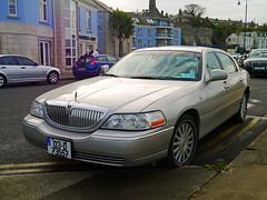 limousine(0.0), automobile(1.0), automotive exterior(1.0), lincoln motor company(1.0), wheel(1.0), vehicle(1.0), full-size car(1.0), bumper(1.0), sedan(1.0), land vehicle(1.0), luxury vehicle(1.0),