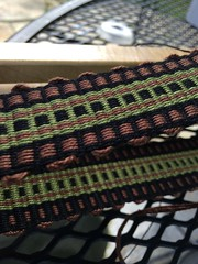 Inkle band woven as rep with one thick and one thin weft.