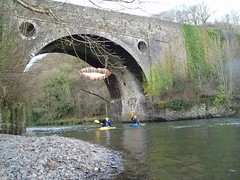 Mike & Crispin just before the wier under a decorated bridge Image