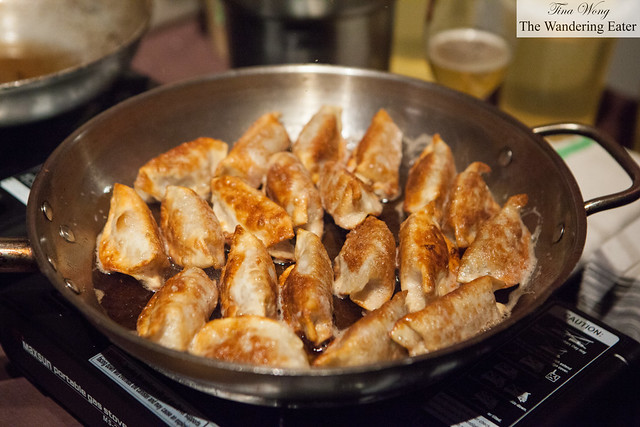Pan of Pretzel pork & chive dumplings by Talde