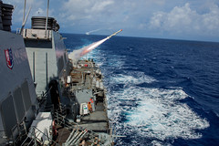 USS Benfold (DDG 65), foreground, and USS John S. McCain (DDG 56) fire Harpoon missiles during an exercise Valiant Shield sink exercise. (U.S. Navy/STG3 Aaron Lyons)