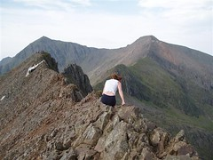 Helen traversing along the ridge line of Crib Goch Image