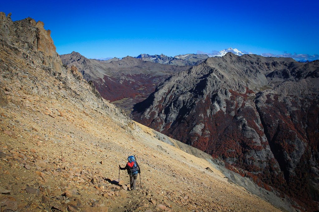 Descending into autumn on a 14-day hike along the Huella Andina route from Bariloche to El Bolson through the Nahuel Huapi National Park and Comarca Andina ranges. Lakes region. Rio Negro. Patagonia. Argentina.