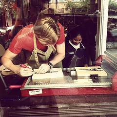 Super cool. Live linocut & letterpress by District Dogs in the window of Bird On A Wire, Main St #yvrart