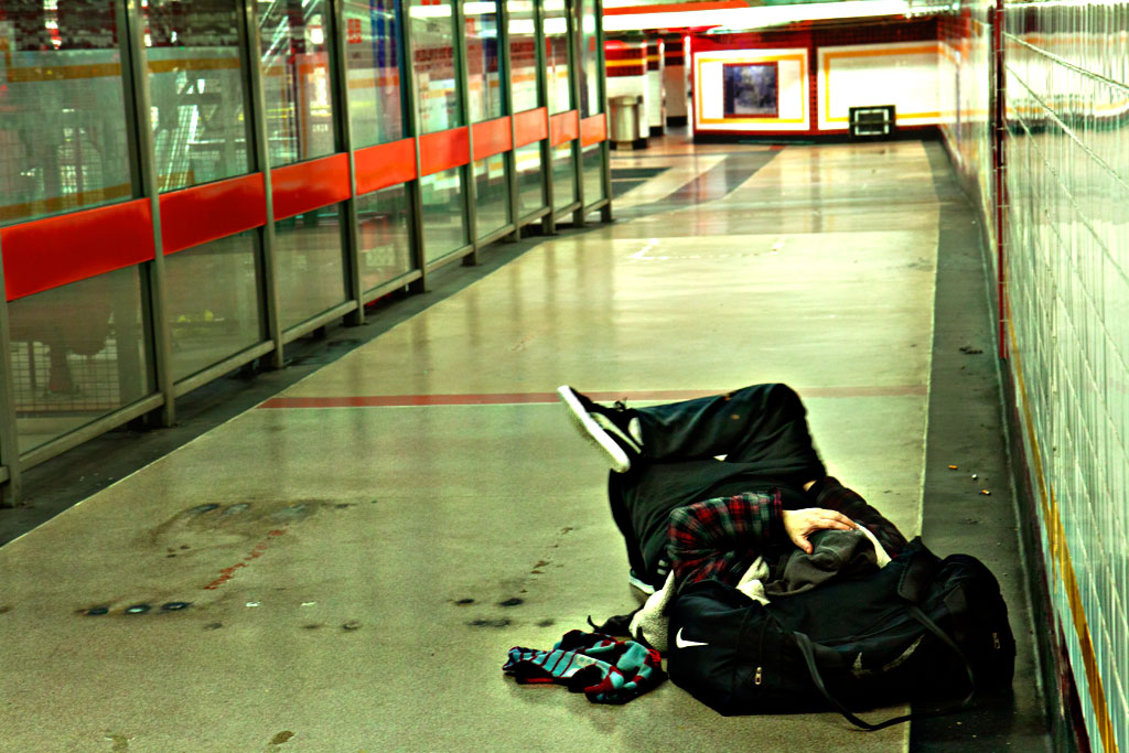 Man-sleeping-in-subway-concourse-on-Christmas-Eve-2014--Center-City
