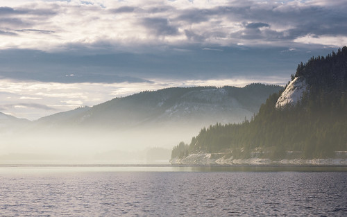 landscape snoqualmiepass nature scenic fog pacificnorthwest hyak canoneos5dmarkiii canon135mmf2lusm clouds sunlight trees water lake mountains winter johnwestrock washington