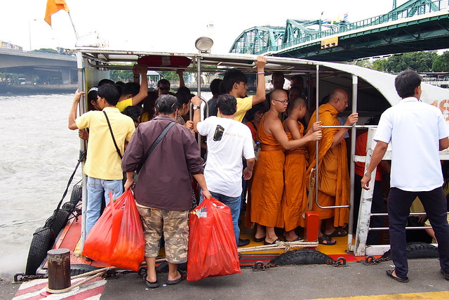 monks on the river boat, Bangkok, Thailand