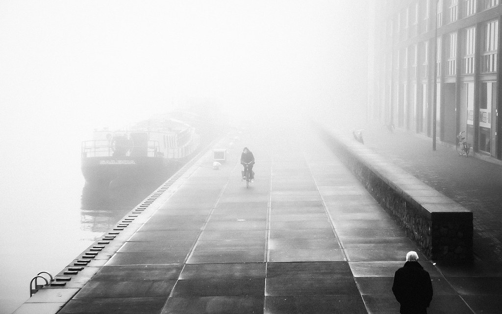 Bicycle street photography in the fog
