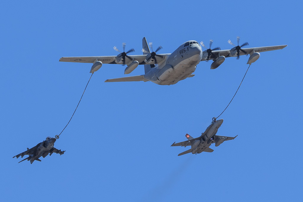 Lockheed KC-130J Super Hercules refueling McDonnell Douglas F/A-18C Hornet and AV-8B Harrier II